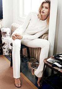 Le-Fashion-Blog-Abbey-Lee-Kershaw-All-White-Holiday-Party-Look-White-Long-Sleeve-Top-White-Pants-Metallic-Heeled-Sandals-Via